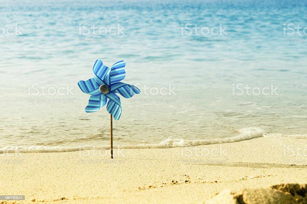 Pinwheel in the sand on a beach royalty-free stock photo