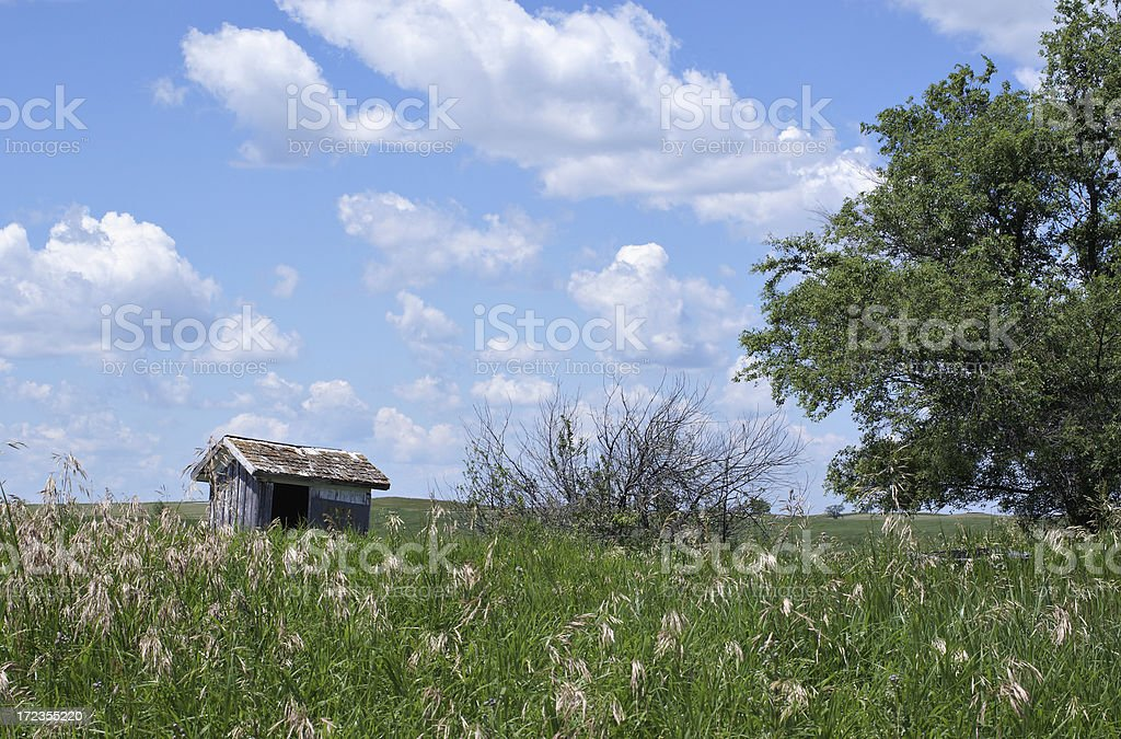 pioneer shack and tall grass royalty-free stock photo