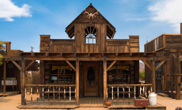 Pioneertown, CA A former Wild West movie set Pioneertown in California. The town was built and used as a decor for many Wild West movies, now it is a tourist attraction. Here are the wooden buildings on the Mane street. saloon stock pictures, royalty-free photos & images