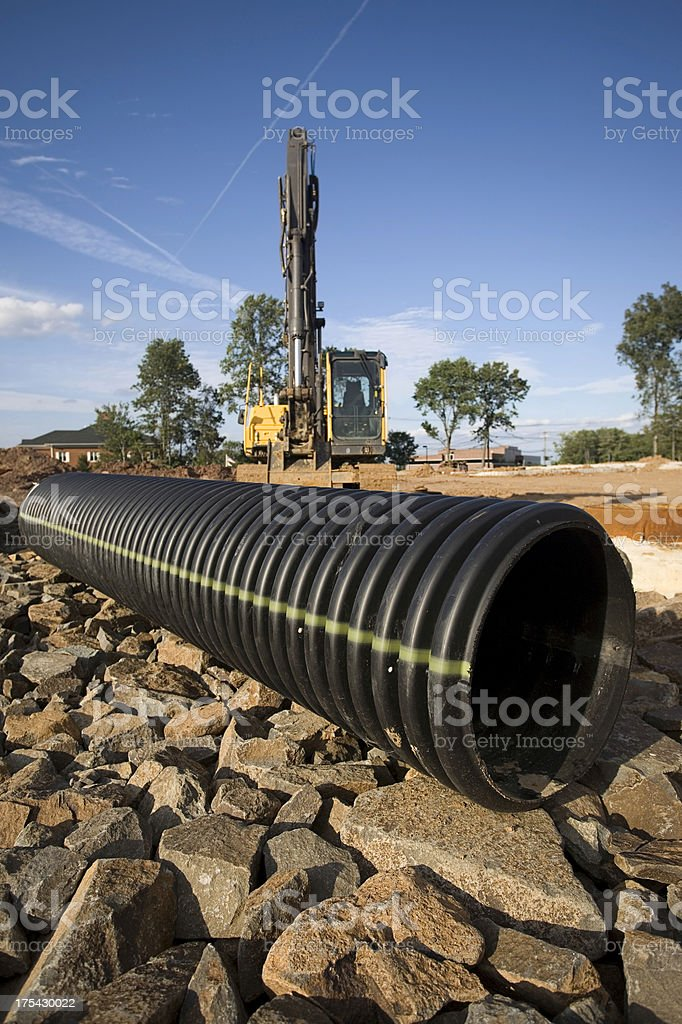 Pipe and Backhoe royalty-free stock photo