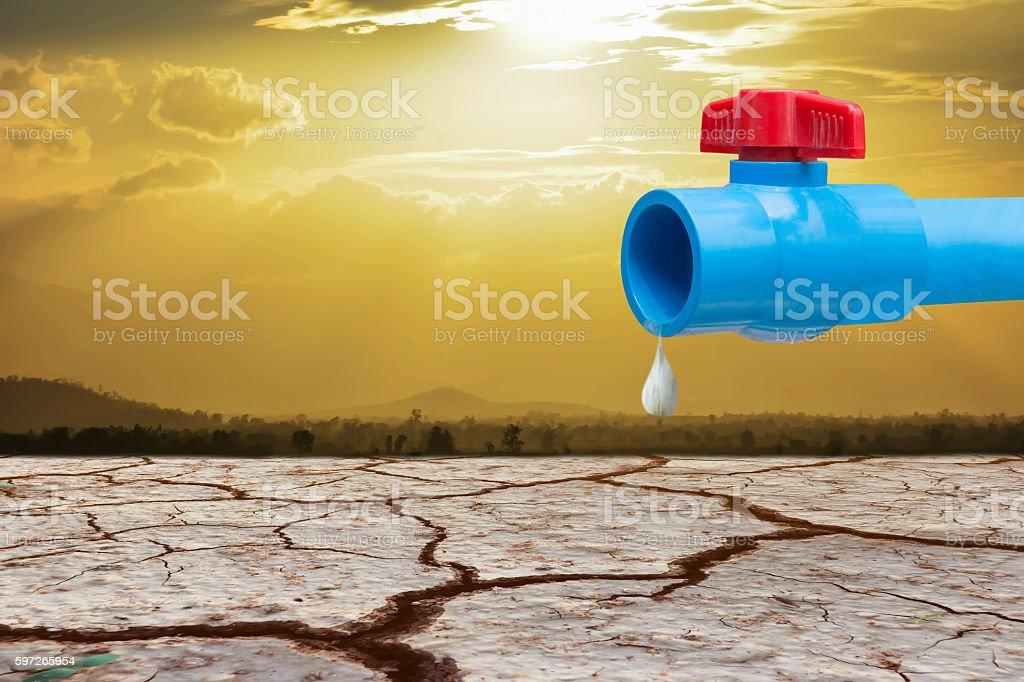 pipe and valve against waterless cracked soil Lizenzfreies stock-foto