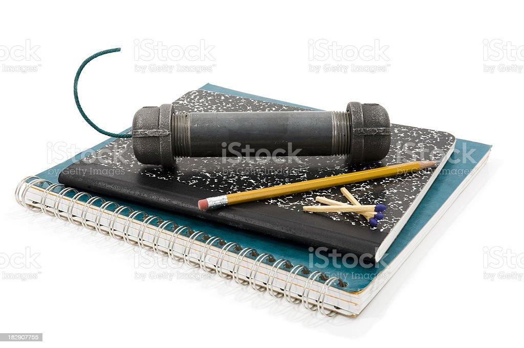 Pipe Bomb sitting on school notebooks stock photo