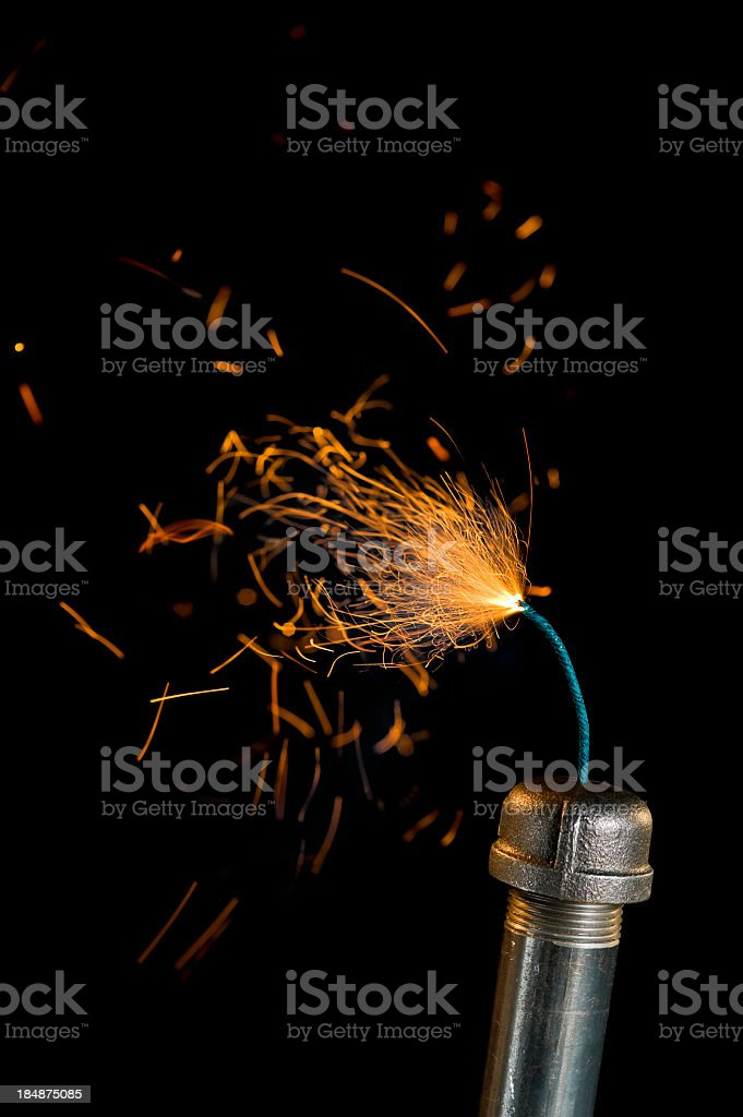 Pipe Bomb with lit fuse stock photo