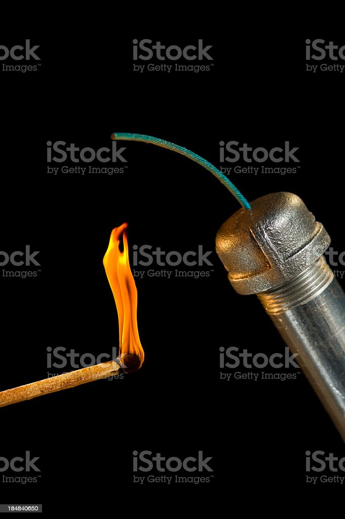 Pipe Bomb with lit match stock photo