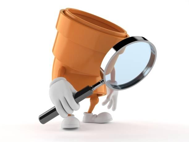 blick durch die lupe pipe-zeichen - detektivhandwerk stock-fotos und bilder