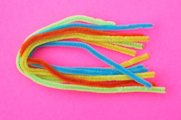 Pipe cleaners, chenille stems on pink background stock photo