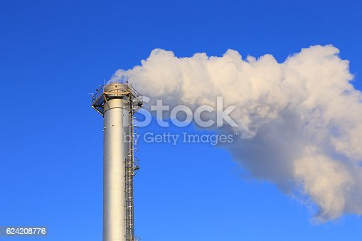 istock Pipe industrial boiler close up and white smoke 624208776