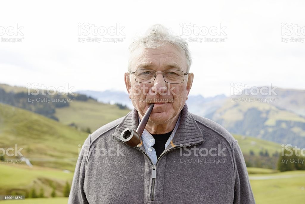 Pipe Smoker in the Mountains stock photo