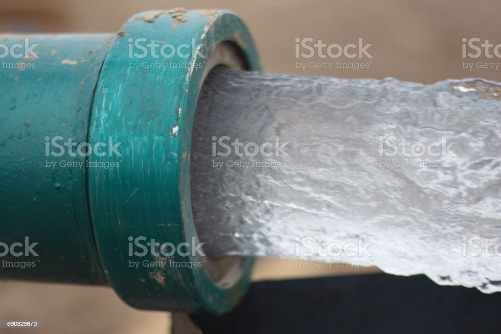 Pipe water flow stock photo
