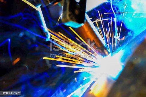 Pipe welding. Welding works. Sparks of welding