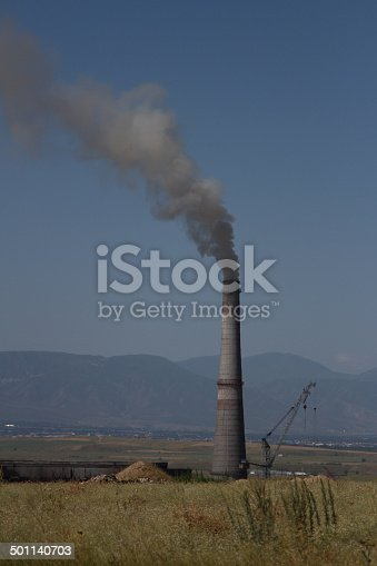 istock pipe with smoke 501140703