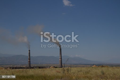 istock pipe with smoke 501191799