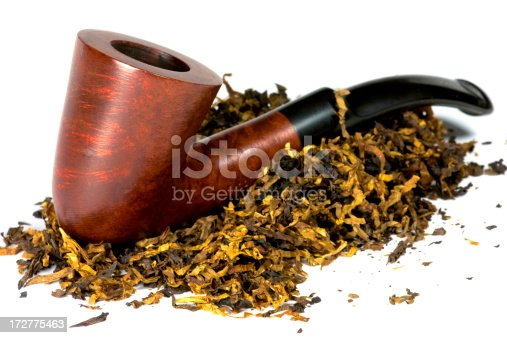 Beautiful and fine pipe made of heather wood with tobacco.
