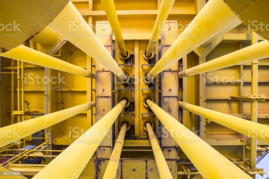 Pipe work on oil and gas wellhead remote platform. stock photo