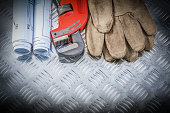 Pipe wrench construction plans leather safety gloves on corrugat