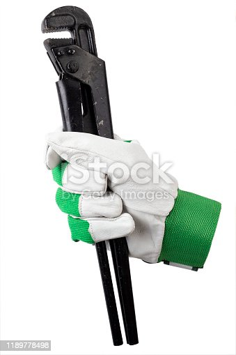 istock pipe wrench in a worker's hand, in a work glove. isolated on a white background. 1189778498