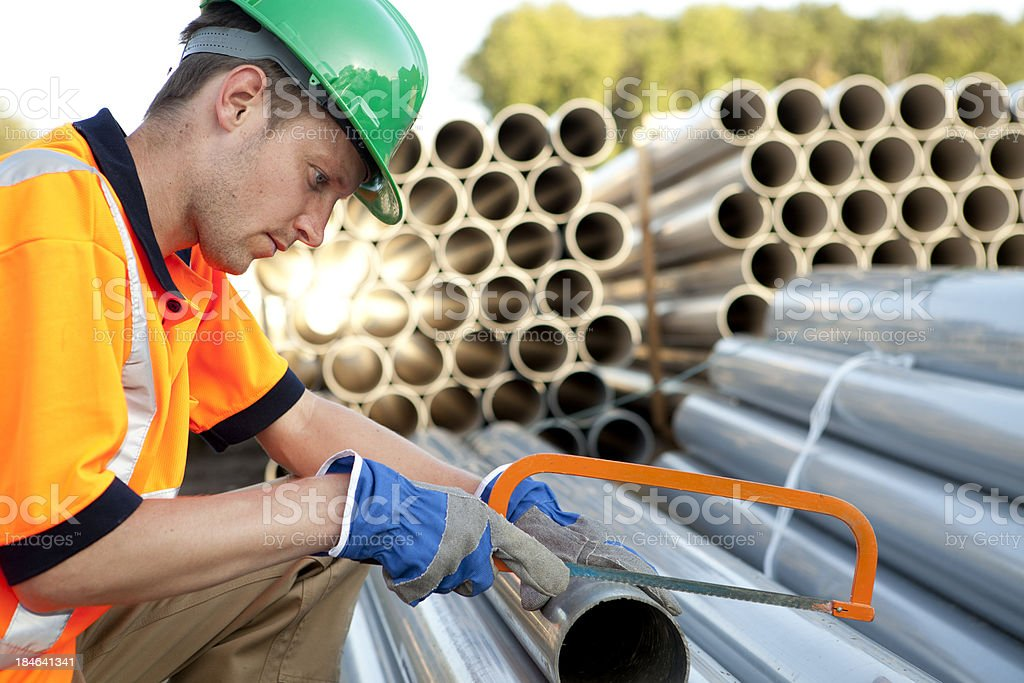 Pipefitter at work with pvc pipes. Sewage assembly. stock photo