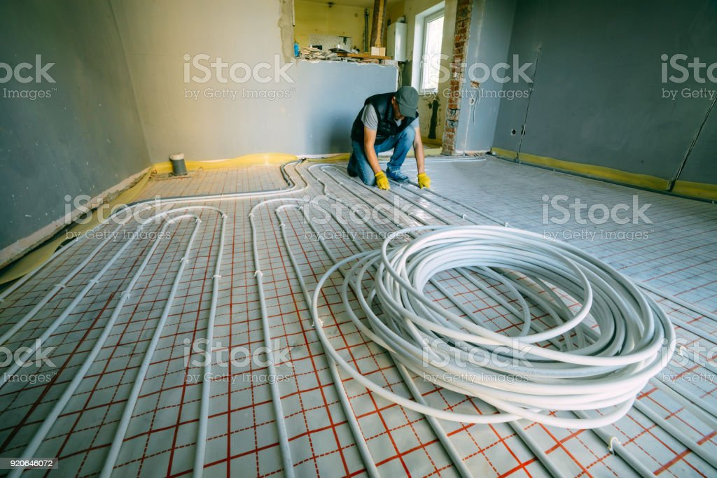 Pipefitter installing system of heating stock photo