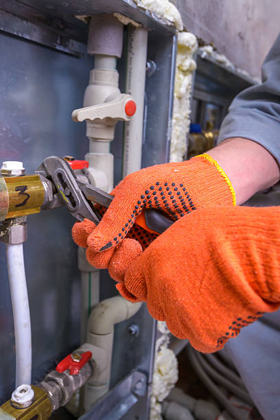 pipefitter pipefitter installing system of heating pipefitter stock pictures, royalty-free photos & images