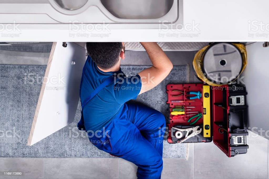 Pipefitter - Plumber Plumber, Sink, Repairman, Kitchen, Water Pipe Accidents and Disasters Stock Photo