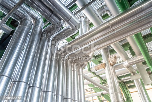 istock Pipeline and insulation at industrial zone,Pipe of steam at power plant 1065466772