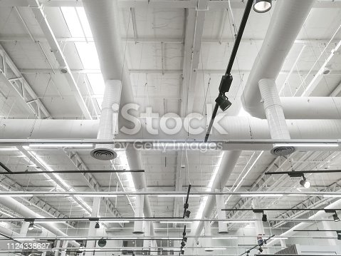 istock Pipeline and lighting above the ceiling of supermarket store 1124338627
