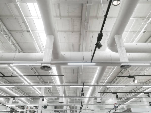 Pipeline and lighting above the ceiling of supermarket store Pipeline and lighting above the ceiling of supermarket store ceiling stock pictures, royalty-free photos & images
