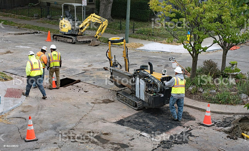 Pipeline Crew Relocating Horizontal Directional Drill stock photo