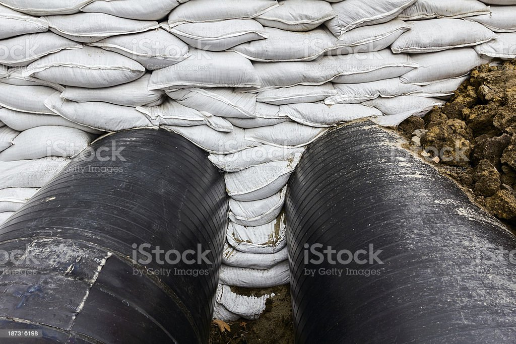 Pipeline passes under the road royalty-free stock photo