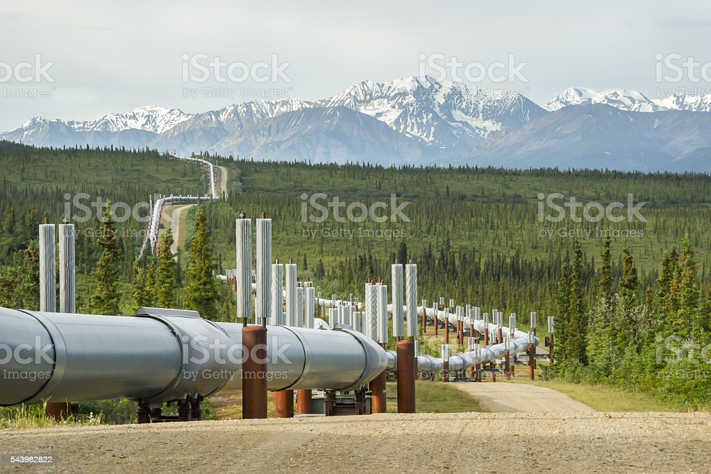 Pipeline Winding in Summer Mountain Landscape stock photo