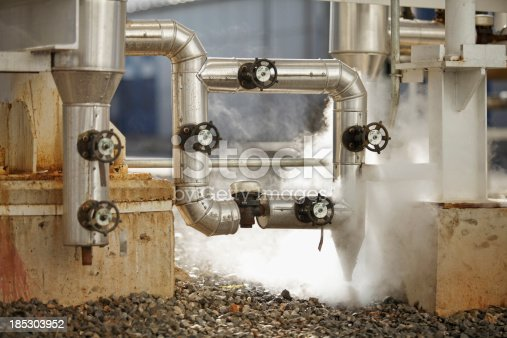 pipelines emitting steam at industrial sitesimilar images: