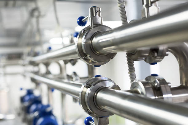 Pipelines from stainless steel, a system for pumping liquids for the food industry Pipelines from stainless steel, a system for pumping liquids for the food industry. Abstract industrial background. coupling device stock pictures, royalty-free photos & images