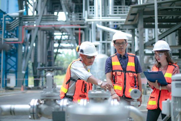 Pipelines, oil and engineer safety manager accompanied by his secretary and engineers conduct inspection chemical plant stock pictures, royalty-free photos & images