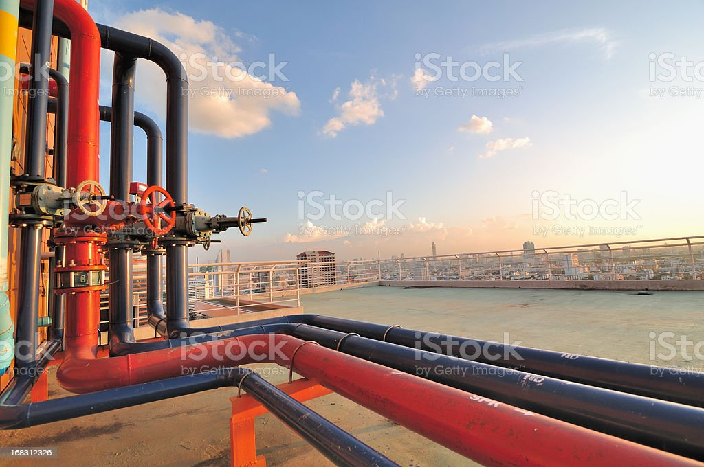 Pipelines on roof top of urban factory royalty-free stock photo