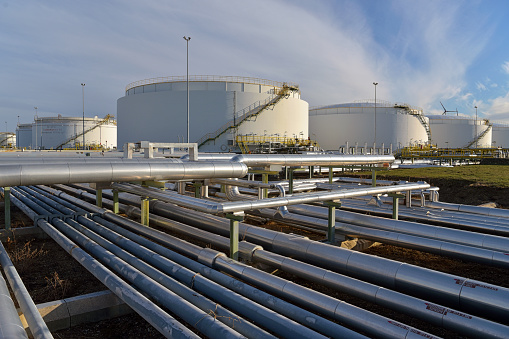 pipeline,storage tanks and buildings of a refinery - industrial plant for fuel production