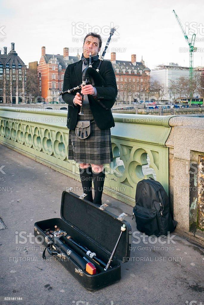 Piper on Westminster Bridge, London stock photo