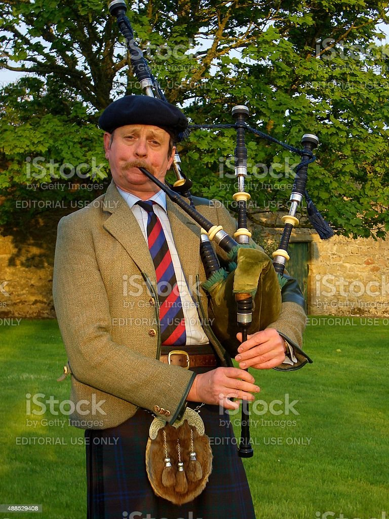 Piper playing bagpipes in Banffshire, Scotland stock photo