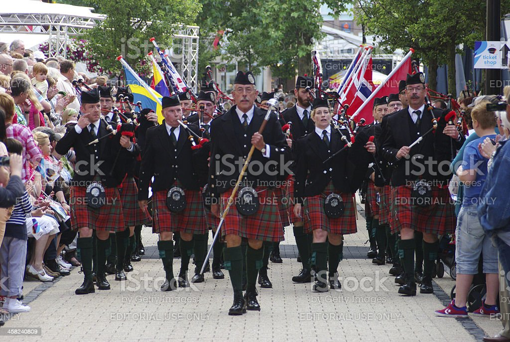 Piperband is marching in the parade royalty-free stock photo