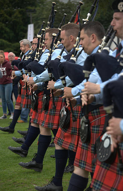 pipers in line at world pipe band championships. - sports championship stock photos and pictures