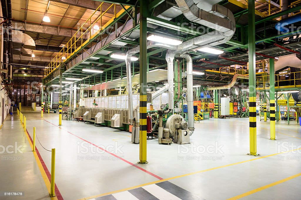 Pipes and industrial equipment inside aluminium processing plant stock photo