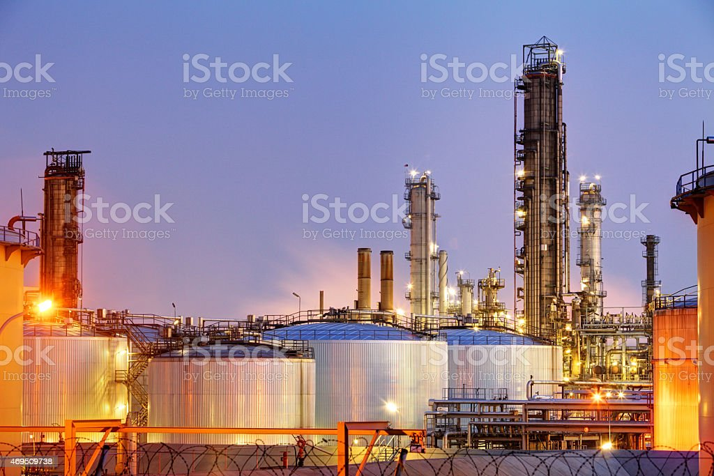 Pipes and tanks of oil refinery - factory stock photo