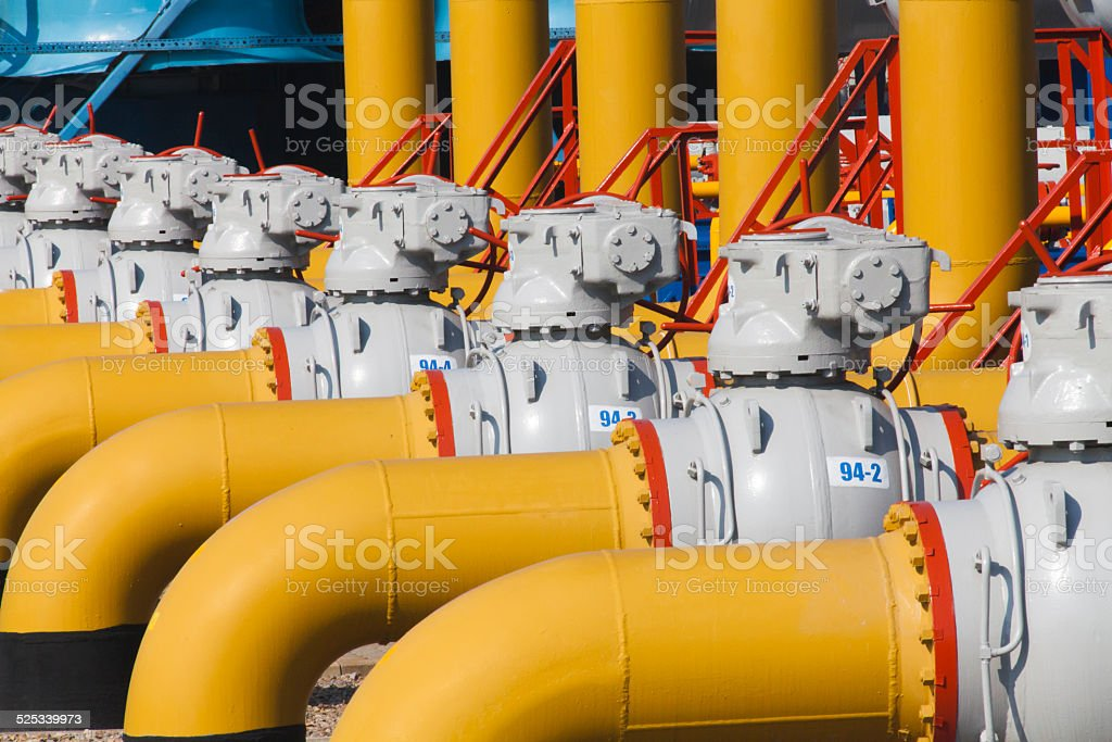 Pipes and valves are on the gas compressor station stock photo