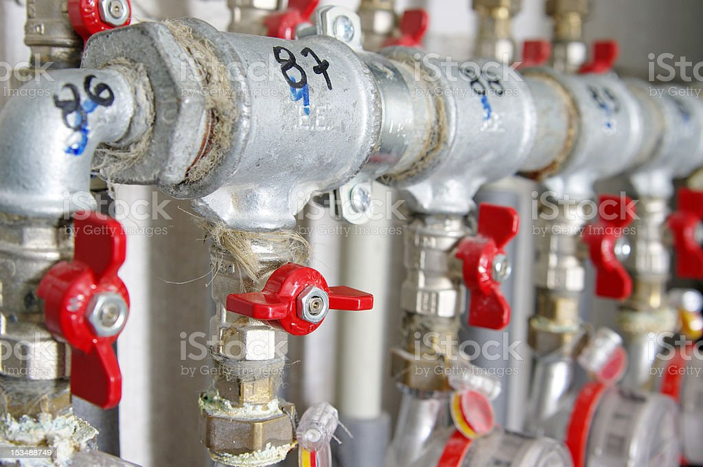 Pipes and valves for warm watter royalty-free stock photo