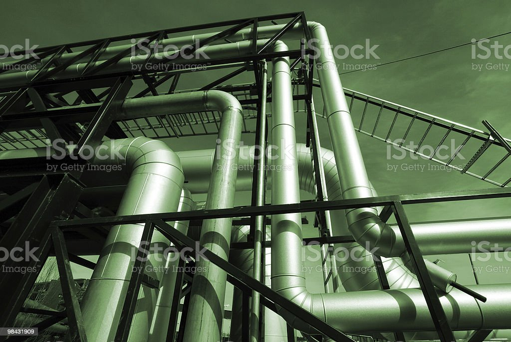 Pipes, bolts, valves  in green tones royalty-free stock photo