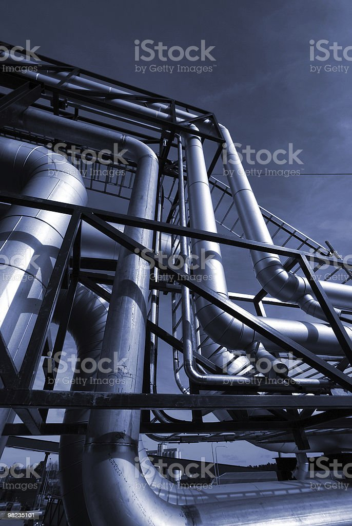 Pipes, cables, valves  in blue tones royalty-free stock photo