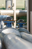 istock Pipes for cooling with taps.Chillers pipes.Metal pipeline and mechanic concept 1291184925
