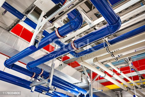 Pipes of different colors in an industrial building