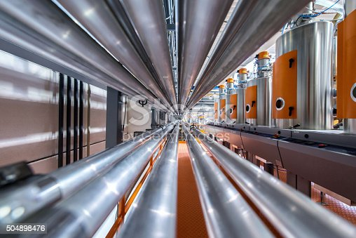 Pipes, tubes, machinery at factory.