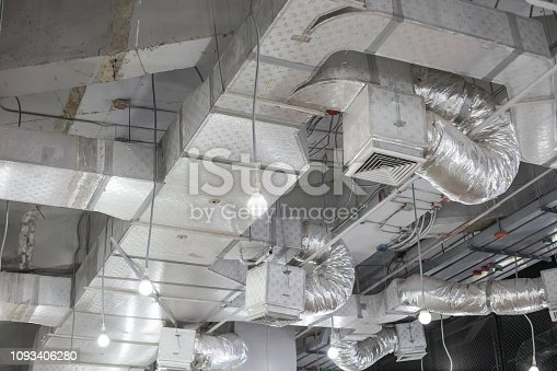 istock Pipes of air conditioning and ceiling electric system 1093406280
