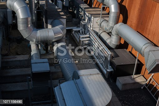 istock pipes on the roof as a part of airconditioning system 1071156490
